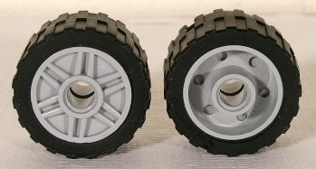 LEGO 55981c01 - Wheel 18mm D. x 14mm with Pin Hole, Fake Bolts and Shallow Spokes with Black Tire 24 x 14 Shallow Tread