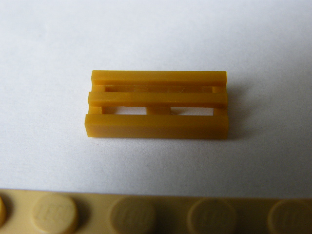LEGO 2415b -  Pearl Gold Tile, Modified 1 x 2 Grille with Bottom Groove