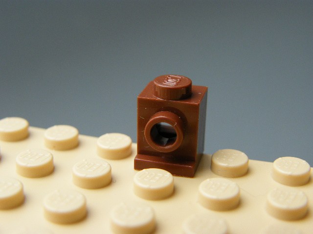 KOSTKA 4070 - Reddish Brown Brick, Modified 1 x 1 with Headlight