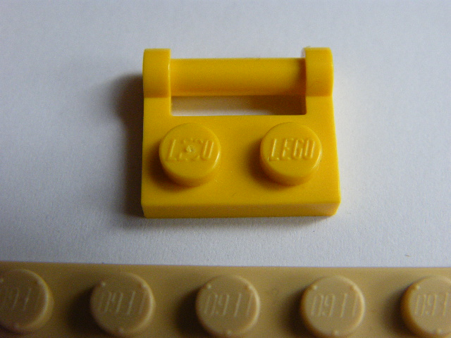 LEGO 48336 - Yellow Plate, Modified 1 x 2 with Handle on Side