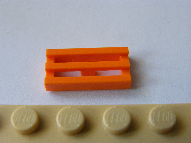 LEGO 2412b - Orange Tile, Modified 1 x 2 Grille with Bottom Groove